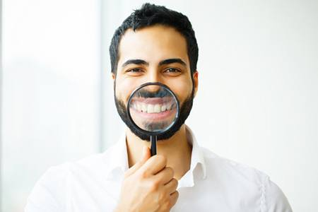 man displaying his smile straightened by Invisalign in Terrell