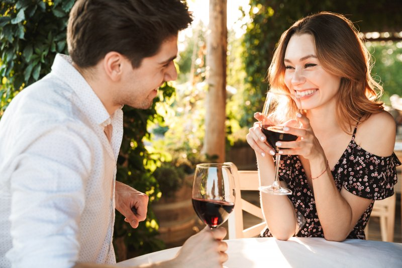 Woman smiling on first date at winery